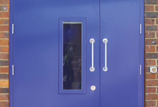 Leaf-and-a-half doorset fitted with pull handles and a single vision panel.
