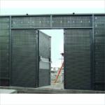 Rear of bi-fold doorset showing panic bar system with blanking panel and anti-vermin mesh.