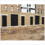 On site installation of louvred doorsets.