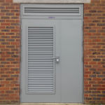 Leaf-and-a-half doorset with louvred door and overpanel.